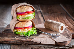 Tasty burger with egg to takeaway Stock Photo