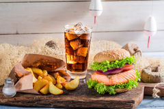 Tasty burger with fish made by fisherman Stock Image