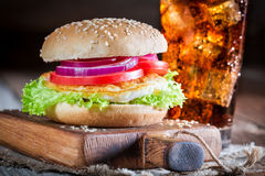 Tasty burger with fried egg and cold drink Stock Images