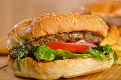 Tasty burger with melted cheese and thick Stock Photography