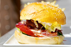 Tasty burger with melted cheese and thick Royalty Free Stock Image