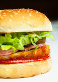 Tasty burger. With salat and bacon royalty free stock image