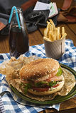Tasty burger with salmon and french fries and soda Stock Photography