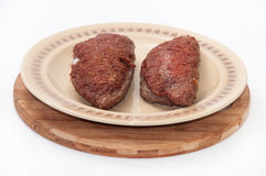 Tasty burger stuffed with cheese on a plate Royalty Free Stock Photography