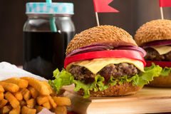 Tasty burgers with flags Royalty Free Stock Photography