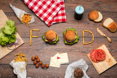 Tasty burgers  forming word food Royalty Free Stock Images