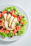 Tasty Caesar salad with chicken, olives and tomatoes stock photography