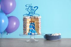 Tasty cake for baby shower party. On table stock image