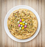 Tasty cake with caramel cream, pistachio and colorful smarties, Stock Photography