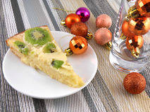 Tasty cake with champagne wine bottle and christmas balls Royalty Free Stock Photo