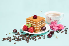 Tasty cake and coffee cup with decoration Stock Image
