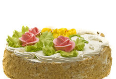 Tasty cake with cream, pink roses Royalty Free Stock Photo