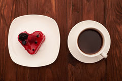 Tasty cake and cup of coffee on drown wooden table Royalty Free Stock Image