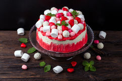 Tasty cake decorated to a marshmallow, colourful coconut balls a Royalty Free Stock Photography