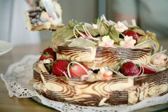 Tasty cake dessert. In the table Royalty Free Stock Photography