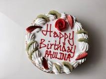 Happy birthday cake. Tasty cake with happy birthday paulina inscription. Cake with strawberry and kiwi stock photos