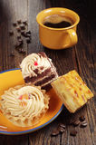 Tasty cakes and coffee Royalty Free Stock Images