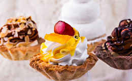 Tasty cakes on a transparent plate Royalty Free Stock Photo