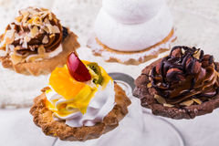 Tasty cakes on a transparent plate Royalty Free Stock Photos