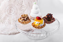 Tasty cakes on a transparent plate Stock Photo