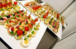 Tasty canapés. Three plates full of little sandwiches. Catering for an event Stock Image