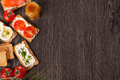 Tasty canapes food border background Stock Image