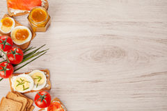 Tasty canapes food border light background Stock Photography