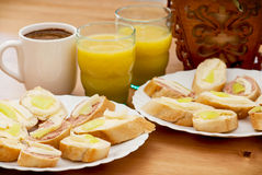 Tasty canapes with juice and coffee Royalty Free Stock Images