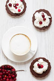 Tasty cappuccino coffee with cookies. Fresh cappuccino, cookies, delicious berries Stock Images