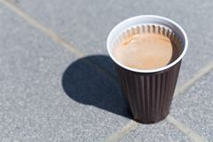 Tasty cappuccino in plastic cup Stock Image