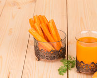 Tasty carrot juice and sticks on wood table. Stock Photography