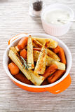 Tasty carrots with roasted parsnips Stock Photos