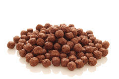 Tasty cereal chocolate balls on a white background Royalty Free Stock Photography
