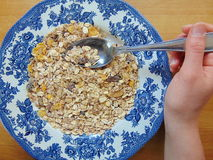 Tasty cereals or muesli for breakfast. With spoon stock photos
