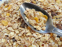 Tasty cereals or muesli for breakfast. With spoon royalty free stock image