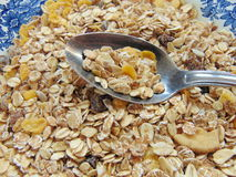 Tasty cereals or muesli for breakfast. With spoon royalty free stock images