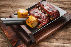 Tasty char grilled ribs served on wood background Stock Images