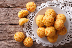 Tasty cheese buns gougere close-up on the table. Horizontal top Stock Photo