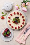 Birthday cheesecake with berries on light background stock photography