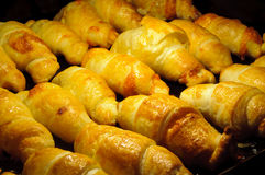 Tasty cheese croissants in the oven. Under heating Stock Images