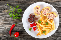 Tasty cheese meat Roll-Ups on dish, top view Royalty Free Stock Photos