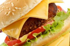 Tasty Cheeseburger clipping path. Tasty Cheeseburger with beef, tomato, letucce and cheese closeup clipping path Royalty Free Stock Image