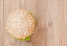 Tasty cheeseburger with lettuce, beef, double cheese and ketchup. Royalty Free Stock Image