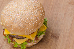 Tasty cheeseburger with lettuce, beef, double cheese and ketchup. Royalty Free Stock Photography