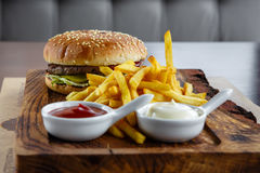 Tasty cheeseburger on wooden board Royalty Free Stock Image