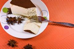 Tasty cheesecake with white coffee decoration. Stock Photo