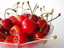 Tasty cherries. In glass bowl Stock Photos