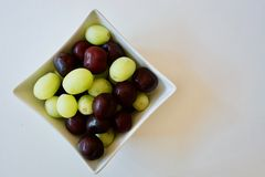Tasty cherries and grapes Stock Photos