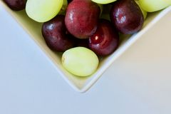 Tasty cherries and grapes Royalty Free Stock Photography
