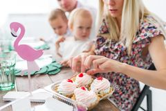 Tasty cherry cakes. Caucasian family, mother, father, son and daughter celebrating a birthday party. royalty free stock photos